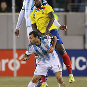 Felipe Caicedo, (centre), Ecuador, is challenged by Javier Mascherano, and Ezequiel Garay, (top), Argentina, during the Argentina Vs Ecuador International friendly football match at MetLife Stadium, New Jersey. USA. 15th November 2013. Photo Tim Clayton