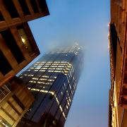 Baltimore Street, downtown Kansas City, MO - looking up at One Kansas City Place tower in fog.