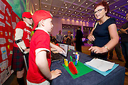 Conor Egan from Buaile Beag NS with Caroline from Medtronic  at  the Medtronic Junior FIRST LEGO League challenge at the Radisson Blu Hotel Galway. This is the second year The Galway Education Centre has hosted this competition - one of only six countries in the world who do so. Following the success of last year, over 500 school children from all over the country are expected to come along and practice their robotics, presentation and teamwork skills live on the night!. .Bernard Kirk, Director of The Galway Education Centre says; ?Working on this three day event every year is fun and exciting and always surprising. The talent, instinct and drive we discover in these young children is an inspiration to all of us. We look forward to the continued success of all of our challenges which would not be possible without the support of companies like Medtronic, SAP, HP and LEGO?. Photo:Andrew Downes