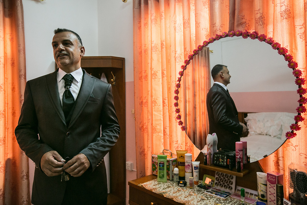 Mahmoud, a former Iraqi army soldier under the Saddam Hussein regime, prepares for his wedding party in Mosul.