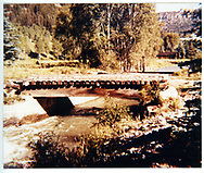 This is probably a road bridge, but it has lots of ties in it and may have been a railroad leftover.