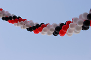 Garland of balloons against blue sky