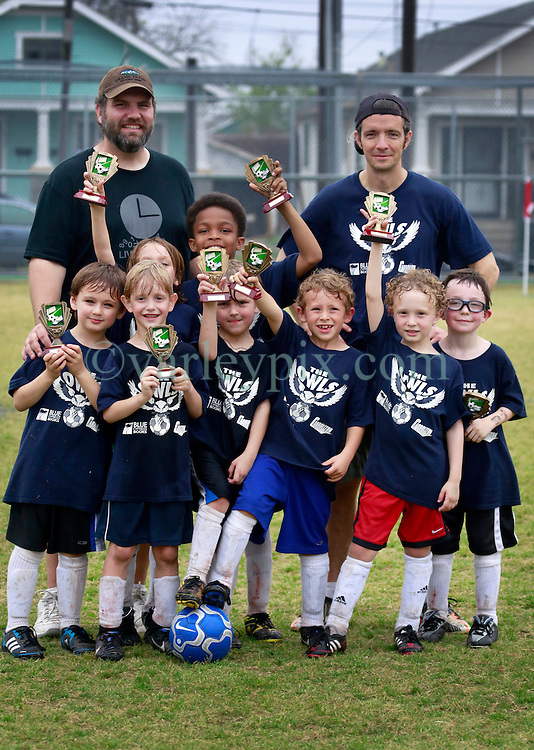 23 March 2013. New Orleans, Louisiana,  USA. .Carrolton Boosters Soccer. Under 8's. 'Owls' emerge victorious, winning the final game of the championship 7-2 against the 'Soldiers.' Lots of bruising games against many valiant opponents..Photo; Charlie Varley.