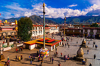 "Overview of Barkhor Square with the Jokhang Temple on the left. Tibetan pilgrims circumambulate the route called ""The Barkhor"" around the temple, which is the most sacred in Tibet. Lhasa, Tibet, China."