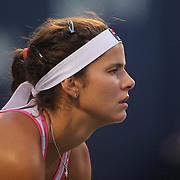 Julia Goerges, Germany, in action against Sloane Stephens, USA, during the New Haven Tennis Open at Yale, Connecticut, USA. 20th August 2013. Photo Tim Clayton