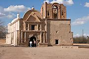 Tourists at the Spanish mission church in Tumacacori National Historical Park, Arizona