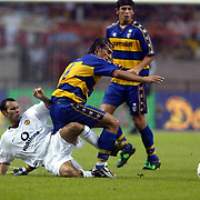 Manchester United's Ryan Giggs and Parma's Aimo Diana battle for the ball