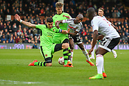 Sone Aluko of Fulham is tackled by Danny Batth and Lee Evans of Wolverhampton Wanderers during the Sky Bet Championship match at Craven Cottage, London<br /> Picture by Richard Brooks/Focus Images Ltd 07947656233<br /> 18/03/2017