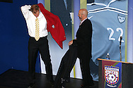 28 August 2006: 2006 Hall of Fame inductee Alexi Lalas (left) puts on his HOF Blazer as Hall of Fame President/CEO Will Lunn (right) looks on. The National Soccer Hall of Fame Induction Ceremony was held at the National Soccer Hall of Fame in Oneonta, New York.