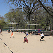 A game of beach volleyball during a warm spring day in Central Park, Manhattan, New York, USA. Photo Tim Clayton