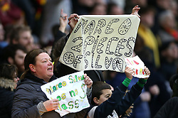A fan holds up a sign reading 'Marco 2 pieces of Silva' in the stands during the Premier League match at Vicarage Road, Watford.