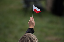 © Licensed to London News Pictures. 26/08/2018. Dublin, Ireland. A woman waves a papal flag Pope Francis arrives in the Phoenix Park Dublin in his popemobile. He said mass to an estimated hundred thousand people. Pope Francis is the 266th Catholic Pope and current sovereign of the Vatican. Photo credit: Barry Cronin/LNP