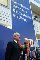 """17 JAN 2002, BERLIN/GERMANY:<br /> Edmund Stoiber, CSU, Ministerpraesident Bayern und CDU/CSU Spitzenkandidat, und Angela Merkel, CDU Bundesvorsitzende,  unter einem Transparent mit der Aufschrift """"Gemeinsam mehr aus Deutschland machen."""" waehrend einem Pressestatement zu einer vorangegangenen Besprechung ueber die Organisation des Bundestagswahlkampfes, CDU Bundesgeschaeftsstelle<br /> IMAGE: 20020117-01-028<br /> KEYWORDS: Ministerpräsident, Mikrofon, microphone, Pressekonferenz"""