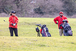 """© Licensed to London News Pictures. 29/03/2021. London, UK. Golfers enjoy an early morning tee off on Wimbledon Common, South West London as the """"Stay at Home"""" government advice ends. From today, Monday 29 March, the """"Stay at Home"""" advice will end with people being allowed to meet up within the """"rule of six"""". Playing golf, tennis and organised outdoor sports will also be allowed as England starts to unlock after a year of Covid-19 restrictions. Photo credit: Alex Lentati/LNP"""
