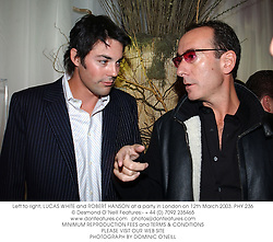 Left to right, LUCAS WHITE and ROBERT HANSON at a party in London on 12th March 2003.	PHY 236