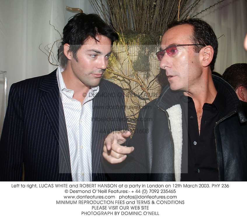 Left to right, LUCAS WHITE and ROBERT HANSON at a party in London on 12th March 2003.PHY 236