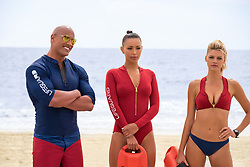 RELEASE DATE: May 26, 2017 TITLE: Baywatch STUDIO: Paramount Pictures DIRECTOR: Seth Gordon PLOT: Two unlikely prospective lifeguards vie for jobs alongside the buff bodies who patrol a beach in California STARRING: Dwayne Johnson as Mitch Buchannon, Ilfenesh Hadera as Stephanie Holden and Kelly Rohrbach as CJ Parker. (Credit: © Paramount Pictures/Entertainment Pictures/ZUMAPRESS.com)