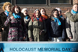 © licensed to London News Pictures. London, UK 27/01/2013. 'A Bridge of Voice' song being sung in a public event to mark Holocaust Memorial Day in central London. Photo credit: Tolga Akmen/LNP