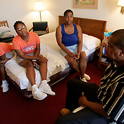 SHREVEPORT, LA - September 2, 2005:  Ralph Finlay and his family narrowly escaped New Orleans alive after trying to stay in their home as Hurricane Katrina hit. They sought shelter in the attic before further fleeing the rising water by chopping a hole in the roof. They sat on their roof for 24 hours (the girls without shirts due to the heat and fleeing with nothing) before being rescued by helicopter. They were sent to a shelter in NO that they felt was too dangerous before fleeing again on foot. They forced their way onto a overcrowded bus and endured a 11 hour bus ride to Shreveport with nothing but the clothes on their back and no where to stay. They went to the Hirsch Memorial Colliseum shelter in Shreveport but left the next day when a stranger gave Ralph $40. Ralph bargained with the owner of a low budget hotel that they are currently staying at. They feel the hotel is also unsafe and Ralph hopes to get work so they can move someplace else. They were given clean clothes and basic necessities, including MRE's (Meals Ready to Eat) at the shelter. ....Ralph's family is as follows: Sedeana Hausey (girlfriend with whom he lives and raises her daughters), 40, her daughter's Chelsa Mims, 11, (on Sedeana's right), and Morissa Brooks, 13 (on Sedeana's left). Photographed inside their Super 8 motel room in Shreveport, LA on Sept 2, 2005. (Photo by Todd Bigelow/Aurora)