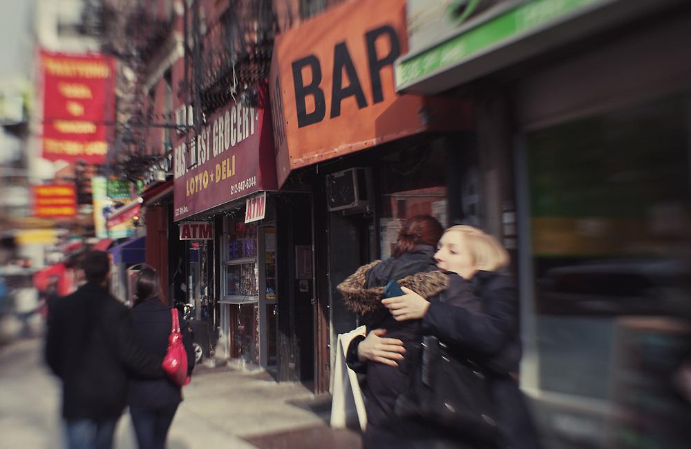 People hugging on eighth Av. NYC 2012
