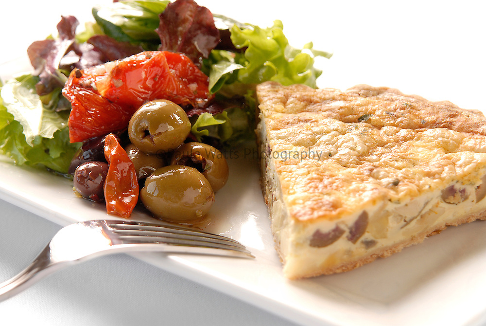 Healthy choice Mediterranean quiche and salad with olives and sun-dried tomatoes