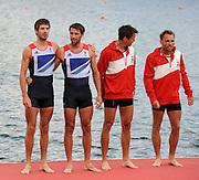 Eton Dorney, Windsor, Great Britain,..2012 London Olympic Regatta, Dorney Lake. Eton Rowing Centre, Berkshire.  Dorney Lake. ..Left. Silver Medalist Men's lightweight double Sculls, Zac PURCHASE and Mark HUNTER right Gold Medalist, DEN LM2X. Rasmus QUIST and Mads RASMUSSEN. ...12:53:36  Saturday  04/08/2012 [Mandatory Credit: Peter Spurrier/Intersport Images]