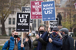 © Licensed to London News Pictures.07/12/2020. London, UK. Pub and restaurant workers gather in support of the hospitality industry at Parliament Square, central London.Photo credit: Marcin Nowak/LNP