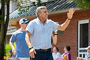 Republican candidate for Pennsylvania governor and former congressman Lou Barletta waves as he walks in the Independence Day Parade in Millville, Pennsylvania on July 5, 2021.
