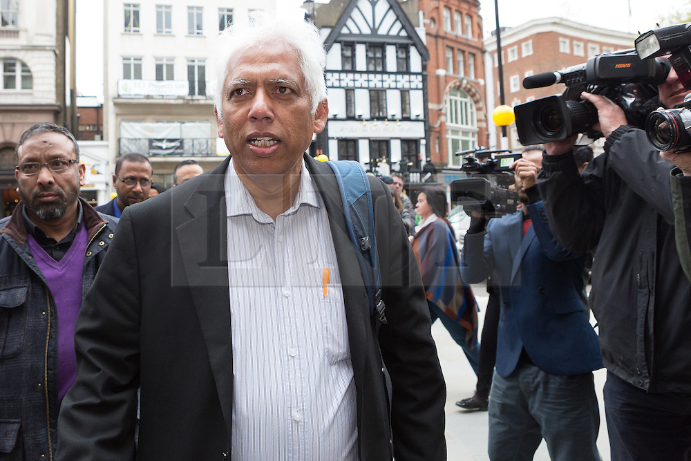 © Licensed to London News Pictures. 23/04/2015. London, UK. Election Petitioner, Amzal Hussain arrives at the Royal Courts of Justice, High Court in London for the ruling of the Tower Hamlets election petition trial. The election petition, brought by four residents, which is led by Andrew Erlam against Lutfur Rahman seeks a re-run of last May's mayoral election in the east London borough of Tower Hamlets.. Photo credit : Vickie Flores/LNP