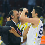 Fenerbahce Ulker's Mirsad TURKCAN (C) celebrate victory during their Turkish Basketball league Play Off Final third leg match Fenerbahce Ulker between Efes Pilsen at the Abdi Ipekci Arena in Istanbul Turkey on Tuesday 25 May 2010. Photo by TURKPIX