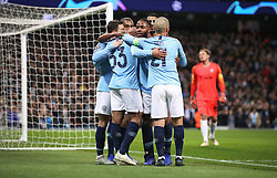 Manchester City's Gabriel Jesus (centre) celebrates scoring his side's second goal of the game with team-mates Raheem Sterling (centre right)
