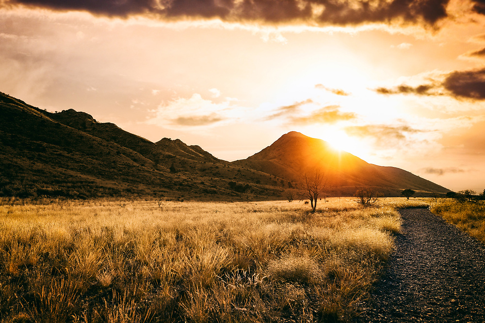 Golden Field Hiking at Sunset in Organ Mountains in Las Cruces, New Mexico. ©justinalexanderbartels.com