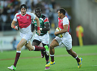 England's Dan Norton, right, runs outside his captain Tom Powell against Kenya in the final at the IRB International Rugby Sevens, Westpac, Wellington, New Zealand, Saturday, February 02, 2013. Credit:SNPA / Ross Setford