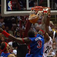 MORNING JOURNAL/DAVID RICHARD.LeBron James slam dunks over Ben Wallace last night in the second half.
