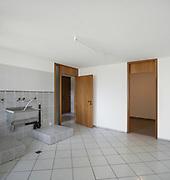 Interior house, empty laundry, gray tiled floor