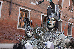 © Licensed to London News Pictures. 18/02/2012. Venice, Italy. People wear masks at a Carnival in Venice 2012. The annual festival, which lasts almost three weeks, see teh streets of venice filled with people wearing costumes and masks. Photo credit: Bettina Strenske/LNP
