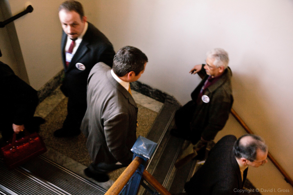 Rep. Chris Tuck (D) descends the stairs of the Alaska State Legislature building, heading for another meeting to advocate for his bill.