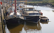 Boats on the quayside at Blakeney, Norfolk, England