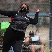 Melyse Begay-Harlan of Crownpoint competes in the discus throw Friday in Zuni.