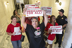 July 19, 2017 - Washington, District Of Columbia, U.S. - Activist MARY JANE MAESTAS chants in the hallway near the entrance to Sen. Marco Rubio's (R-FL) office in the Russell Senate Office Building on Capitol Hill as protesters chant inside. The protesters oppose a senate republican effort to repeal and replace the Affordable Care Act also known as Obama Care. (Credit Image: © Alex Edelman via ZUMA Wire)