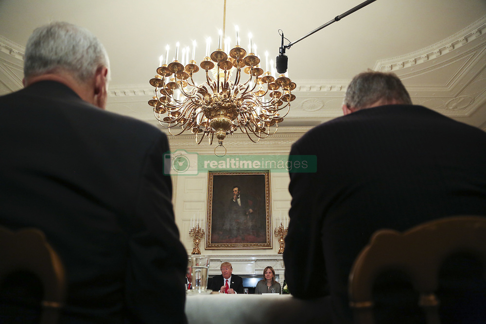 Washington, DC - February 3, 2017; U.S. President Donald speaks before a strategy and policy forum, flanked by and Chief Executive Officer and Chairperson of the General Motors Mary Barra (R) in the State Dining Room of the White House.