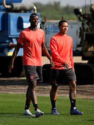 Paul Pogba and Memphis Depay of Manchester United walk to the training pitch - Mandatory by-line: Matt McNulty/JMP - 14/09/2016 - FOOTBALL - Manchester United - Training session ahead of Europa League Group A match against Feyenoord