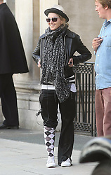 ©London News Pictures. 15/01/2011 .Picture Credit Should read Neil Hall/London News Pictures.Madonna directs her new period film W.E. starring Abbie Cornish about the abdication of King Edward in London on 08/08/2010. Madonna is pictured wearing a trendy hat and one sock rolled up.