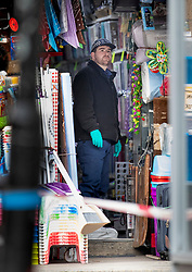 © Licensed to London News Pictures. 03/02/2020. London, UK. A policeman searches inside the Low Price Store on Streatham High Road the day after a terrorist stabbed two people before being shot dead by police. Sudesh Amman, who was released from prison recently for terror offences, was under active police surveillance at the time of the attack - which police think was an Islamist-related terrorist incident. Photo credit: Peter Macdiarmid/LNP