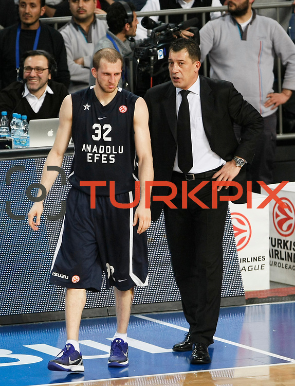 Anadolu Efes's coach Ufuk Sarica (R) during their Turkish Airlines Euroleague Basketball Group C Game 10 match Anadolu Efes between Real Madrid at Sinan Erdem Arena in Istanbul, Turkey, Thursday, December 22, 2011. Photo by TURKPIX