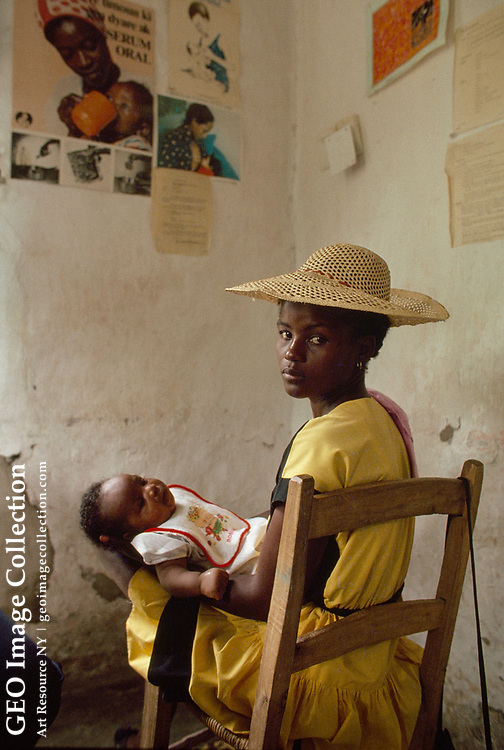 A mother worries for her baby at a rural clinic.