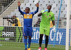 Cape Town City captain Lebogang Manyama and Polokwane City goalkeeper George Chigova in an MTN8 quarter-final match at the Cape Town Stadium on August 12, 2017 in Cape Town, South Africa.
