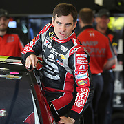 Driver Jeff Gordon exits his car during the 56th Annual NASCAR Daytona 500 practice session that got delayed by rain, at Daytona International Speedway on Saturday, February 22, 2014 in Daytona Beach, Florida.  (AP Photo/Alex Menendez)