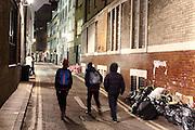 Bridle Lane in Soho, London, at night