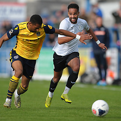 TELFORD COPYRIGHT MIKE SHERIDAN Brendon Daniels of Telford takes on Reiss McNally during the Vanarama National League Conference North fixture between AFC Telford United and Guiseley on Saturday, October 19, 2019.<br /> <br /> Picture credit: Mike Sheridan/Ultrapress<br /> <br /> MS201920-026